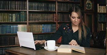 Law student working in a library